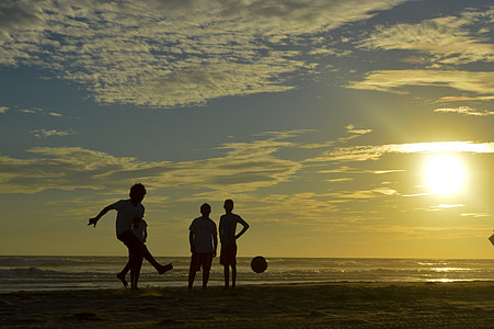 silhouette photo of people playing in the beach