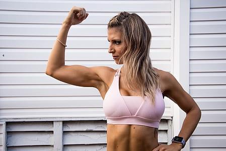woman in pink racerback sport bra