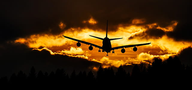 silhouette of plane and clouds