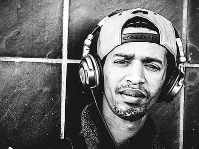 grayscale photo of man wearing headphones