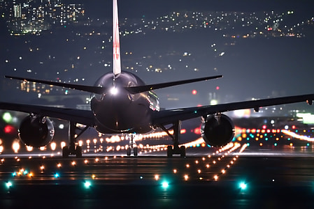 low light photographed of gray plane on pathway