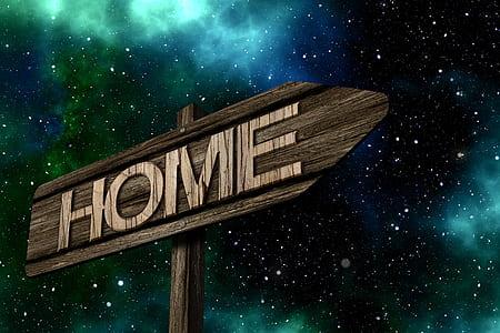 brown wooden Home signage under galaxy