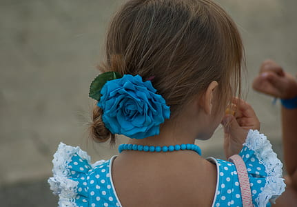 girl wearing blue floral hair bow