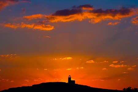 photography of lighthouse during golden hour