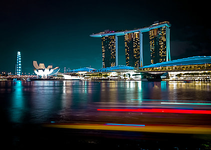 timelapse photography of city high-rise buildings during night time