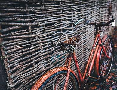photo of red city bike