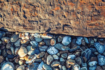 This is a shot captured on the beach at Deal In Kent England, the beach pebbles rest beside an old wooden groyne