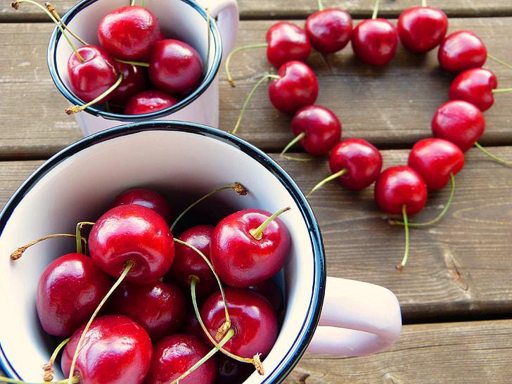 red cherry on ceramic mugs