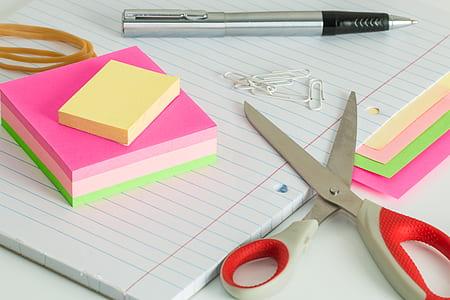 scissors near note pad