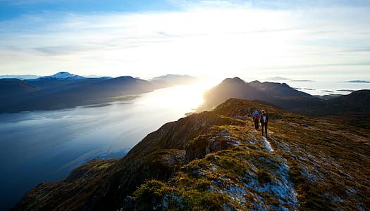 two person on mountain photography
