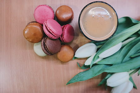 macaroons beside glass with brown liquid