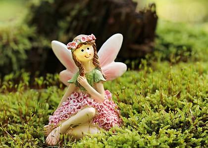 girl fairy ceramic figurine on land