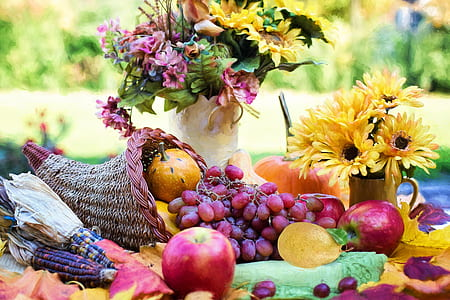 variety of fruits and flowers at daytime