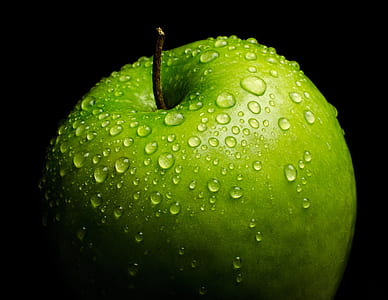 green apple with dew drop