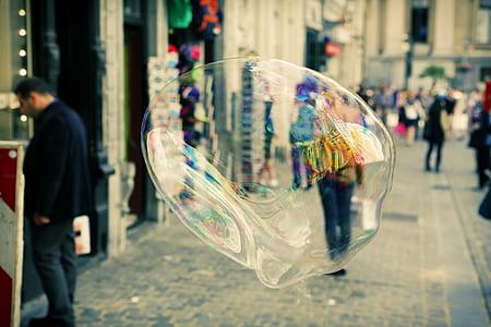 timelapse photography of bubbles near concrete building
