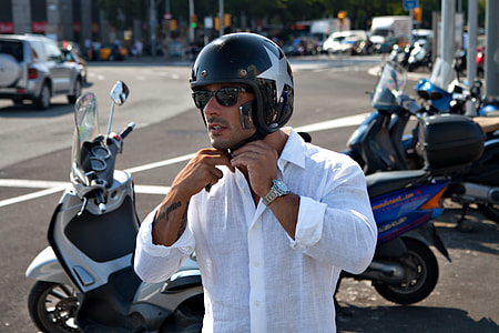 Street shot of a biker in the centre of Barcelona, Spain. Image captured with a Canon DSLR