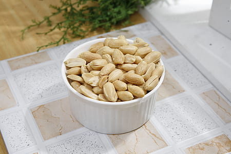 close up photograph of white ramekin with nuts