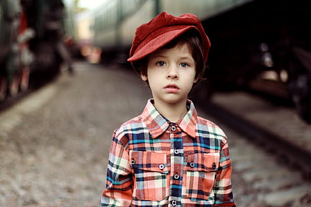 boy wearing red hat