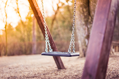 Swing For Kids in City Park Playground #2