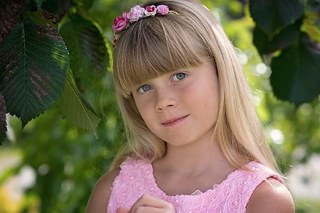girl wearing pink top