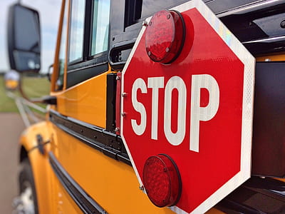 Stop signage on vehicle