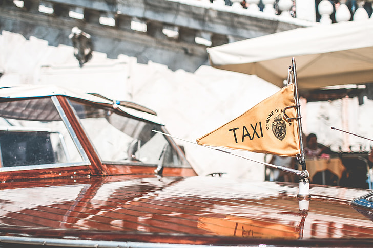 Flag on Iconic Boat Taxi in Venice, Italy