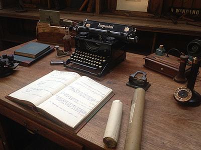black Imperial typewriter near book