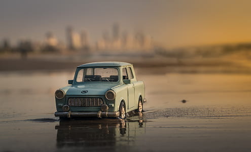 blue car on body of water photo