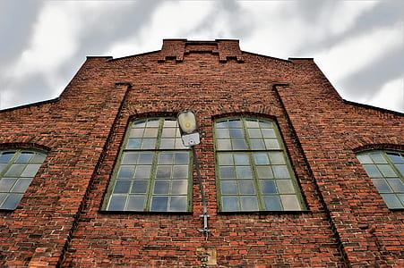 brown concrete brick wall building