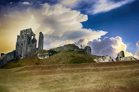 gray concrete ruins under white cloudy sky