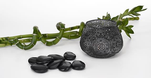 black stones and black vase