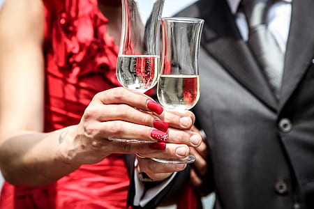 man and woman holding glass of champagne
