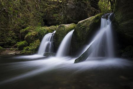closeup photography of green mountain and falls