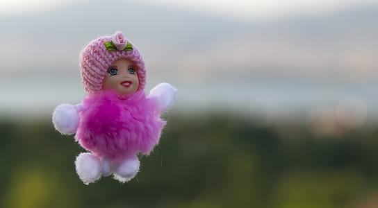 pink and white doll