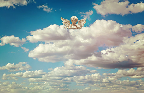 cherub resting his head on white clouds