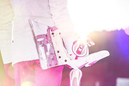 Young Woman Holding Her Pink Snowboard