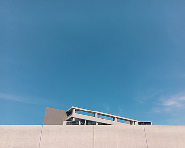 white concrete building under clear blue sky during daytime