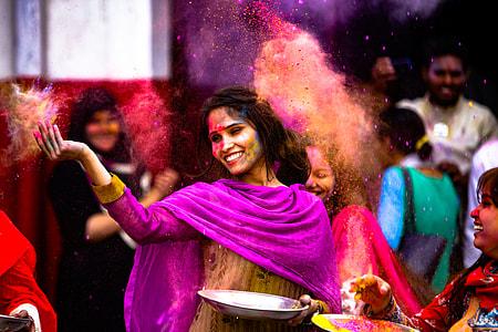 woman wearing sari near people