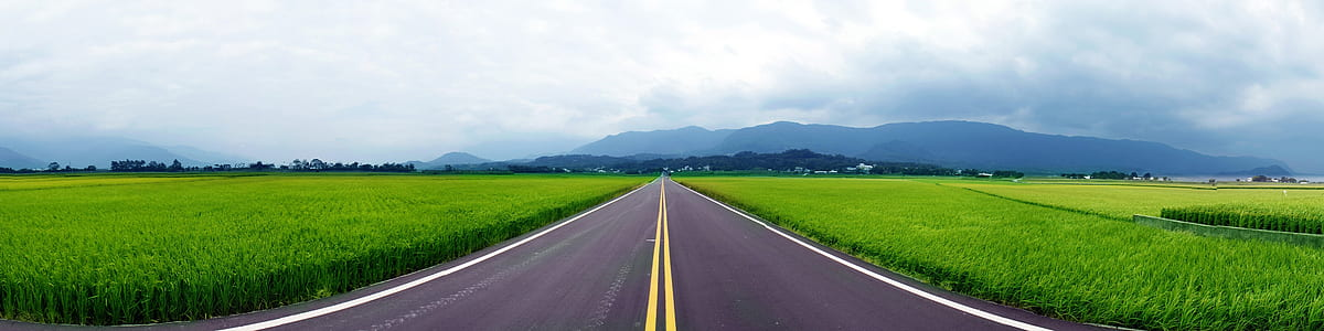 panorama photography of gray concrete pavement with mountain as background