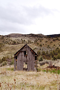 brown barn surrounded with grass
