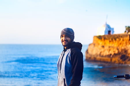 Man Wearing Gray Knit Cap and Pullover Hoodie Beside Beach