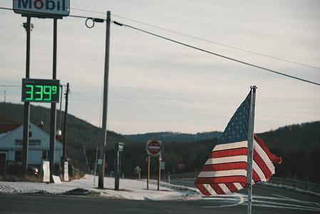US flag near gasoline station