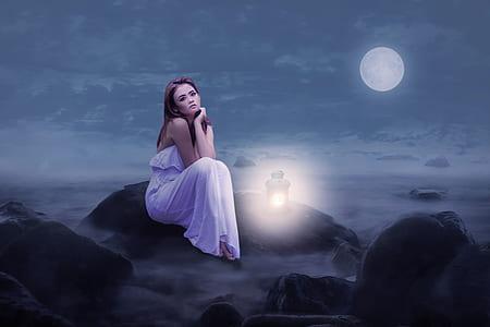 woman wearing purple dress during night time
