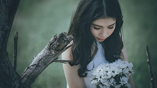 Woman Wearing White Halter Top Holding White Flower Bouquet