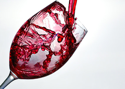 clear wine glass with red liquid