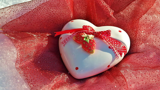 heart-shaped white decor on red textile