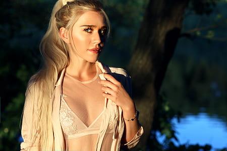 woman wears white floral bra