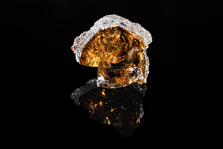 amber stone with black background