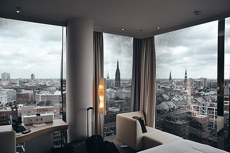 open window curtains and high rise buildings