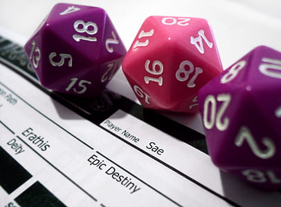 close-up photography of three assorted-color dice